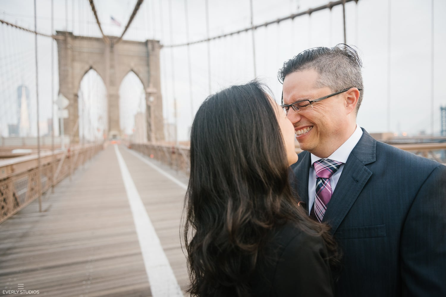 Brooklyn Bridge engagement photos. Photos by New York wedding photographer Everly Studios, www.everlystudios.com