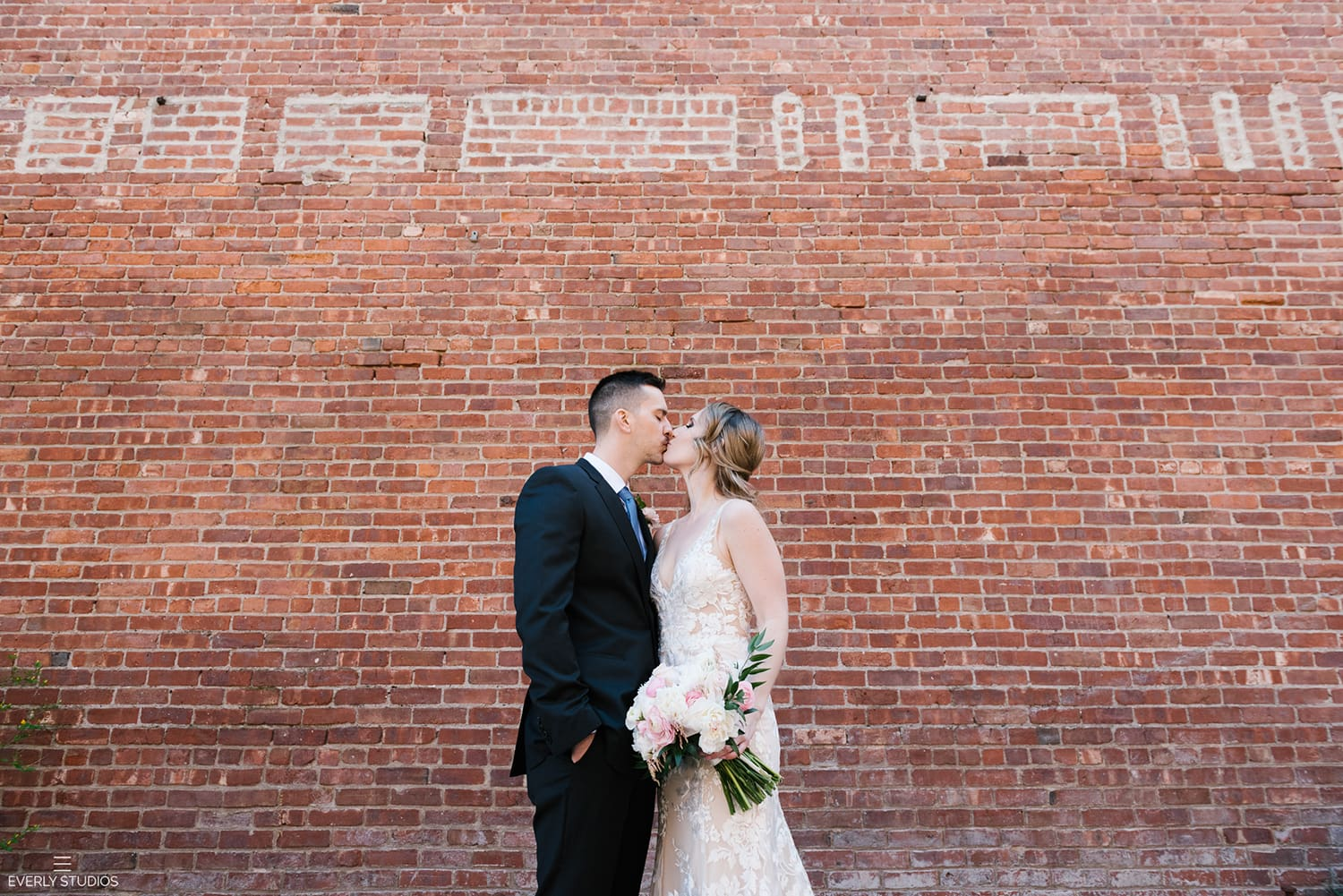 Brooklyn Bridge Park wedding photos in DUMBO, Brooklyn. Photos by New York wedding photographer Everly Studios, www.everlystudios.com