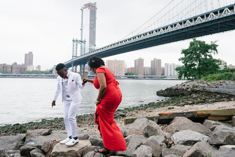 Brooklyn Bridge Park gay wedding photos with bride and trans groom. Photos by New York wedding photographer Everly Studios, www.everlystudios.com