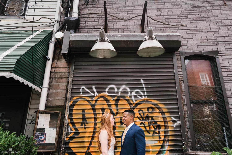 Brooklyn Winery wedding in Williamsburg, Brooklyn. Untraditional wedding portraits in Williamsburg with graffiti and industrial warehouses. Photos by Brooklyn wedding photographer Everly Studios, www.everlystudios.com
