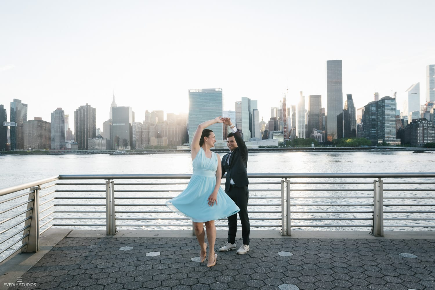 where to elope in NYC: Gantry Plaza State Park engagement photo session in Long Island City, Queens. Photos by NYC wedding photographer Everly Studios