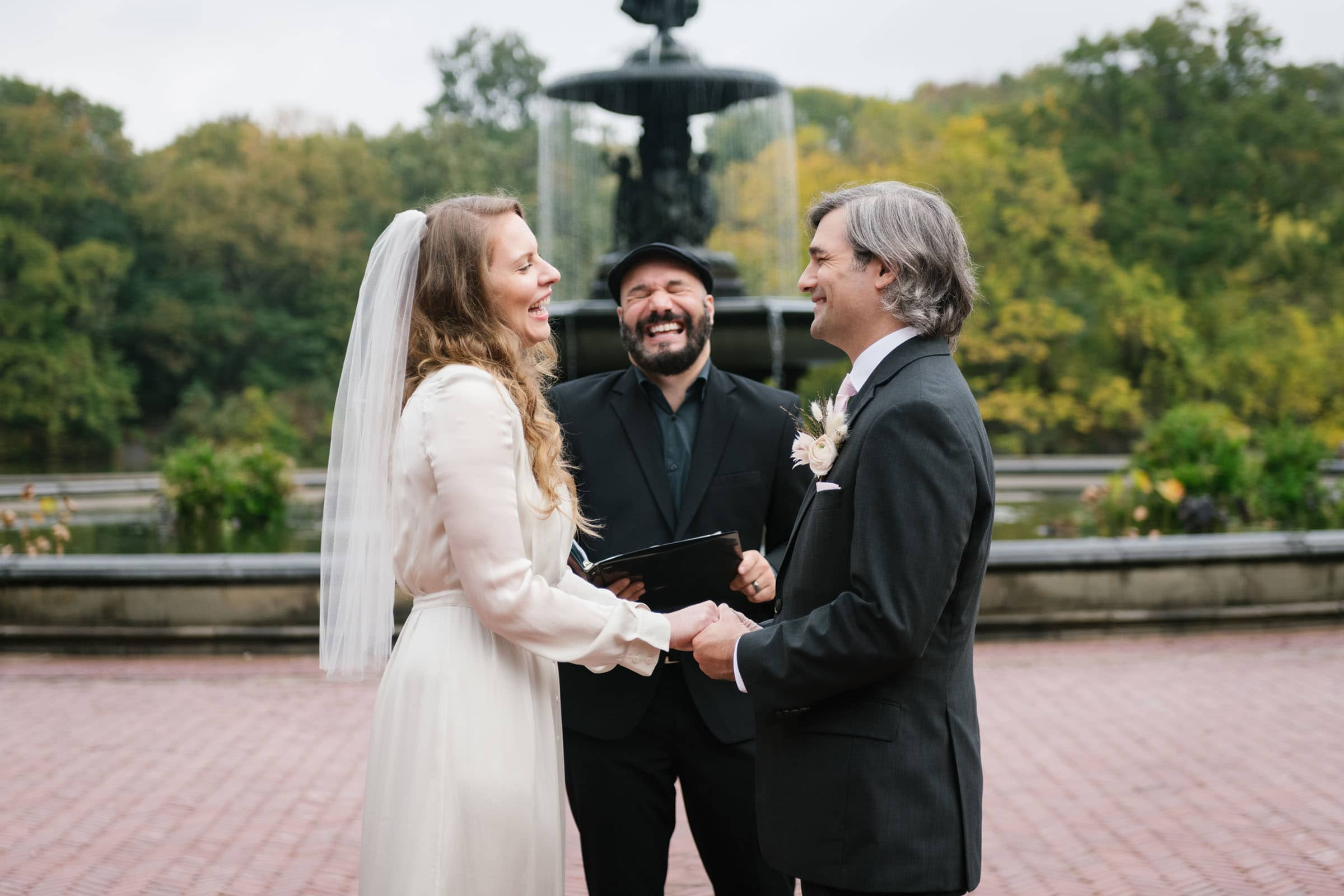 Bethesda Fountain elopement in Central Park NYC. Small wedding at Bethesda Terrace and Fountain in New York.